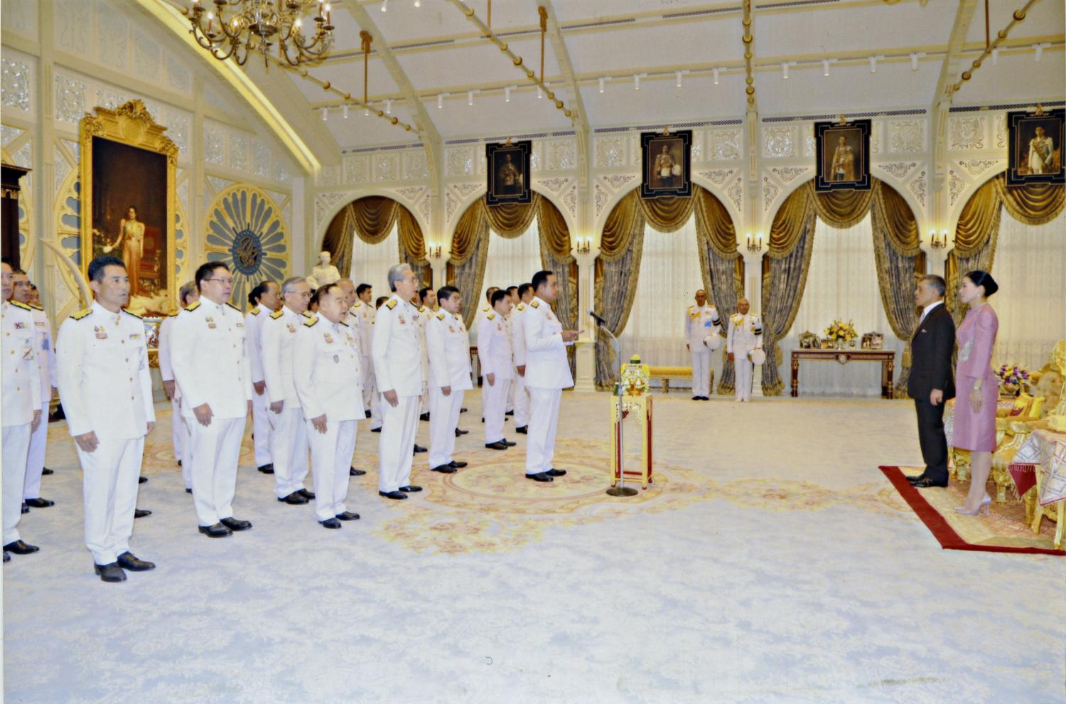 His Majesty the King gives an address to 36 cabinet ministers led by Prime Minister Prayut Chan-o-cha after they took an oath of office during the swearing-in ceremony at the Ambara Villa in the Dusit Palace yesterday. His Majesty was accompanied by Her Majesty the Queen. photo courtesy of the Royal Household Bureau