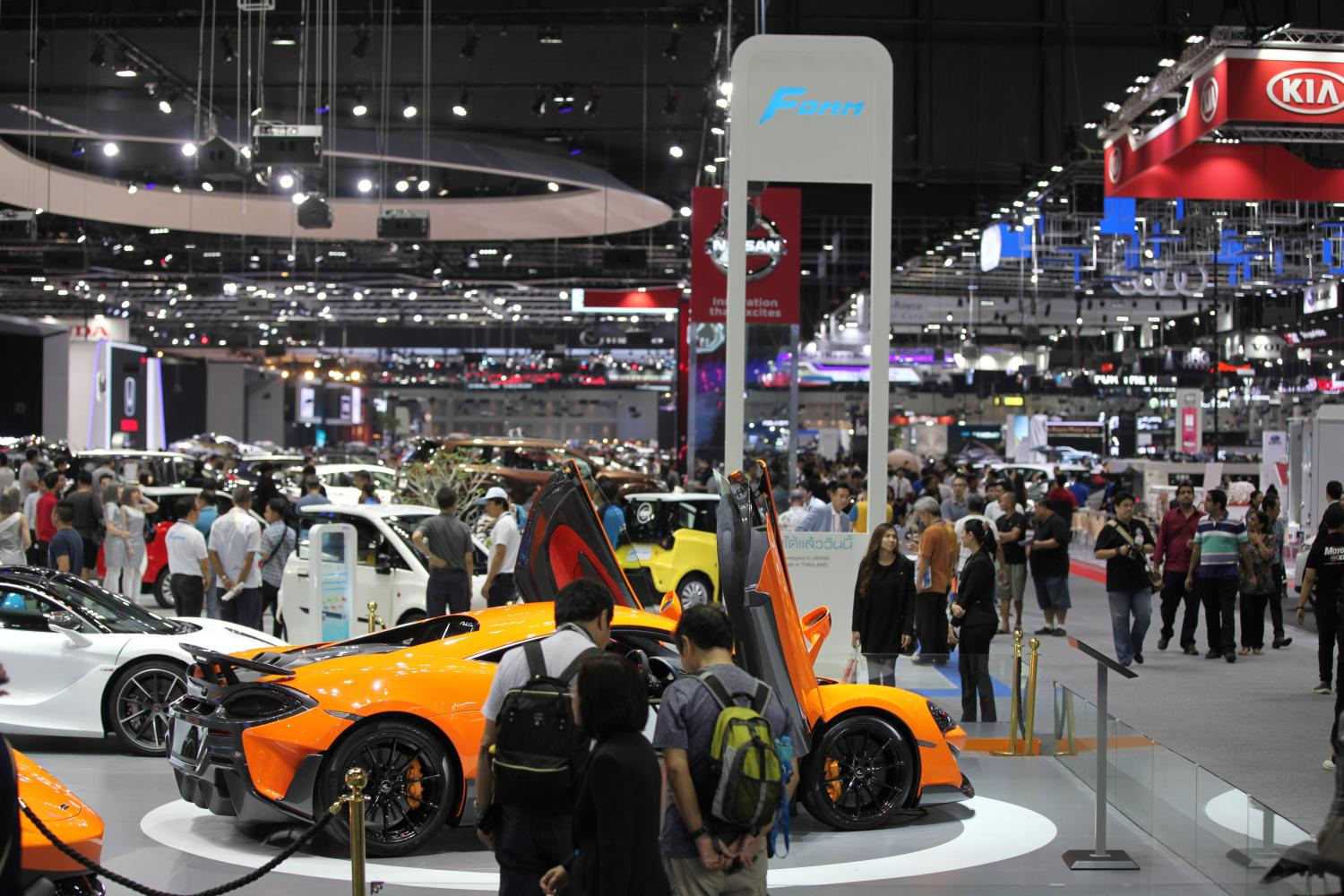 Potential buyers browse vehicles at a motor show. The Federation of Thai Industries says car sales in June fell for the first time in 30 months.(Bangkok Post photo)