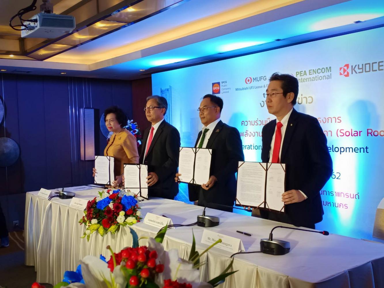 From leftMrs Wandee, Mr Nemoto, Khemmarat Sartpreecha, acting managing director of PEA Encom, and Mr Tamagawa display the joint venture.