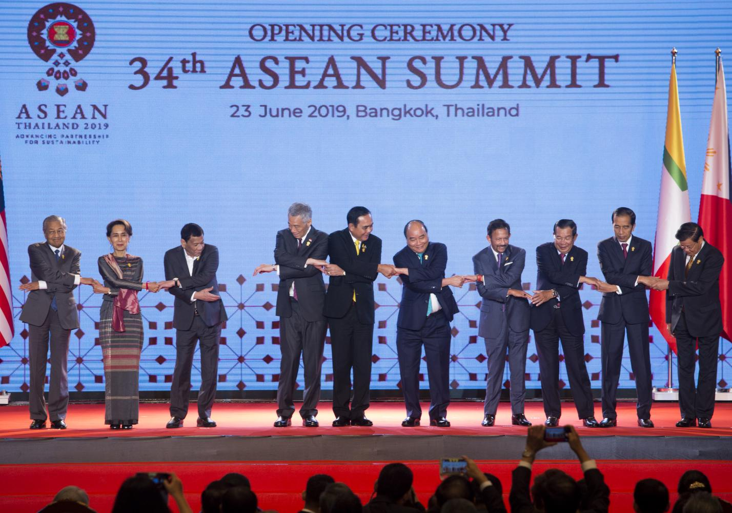 Asean leaders link hands on stage during the 34th Asean Summit in Bangkok on June 23 when they launched the 'Asean Outlook on the Indo-Pacific' (AOIP). PATTARAPONG CHATPATTARASILL
