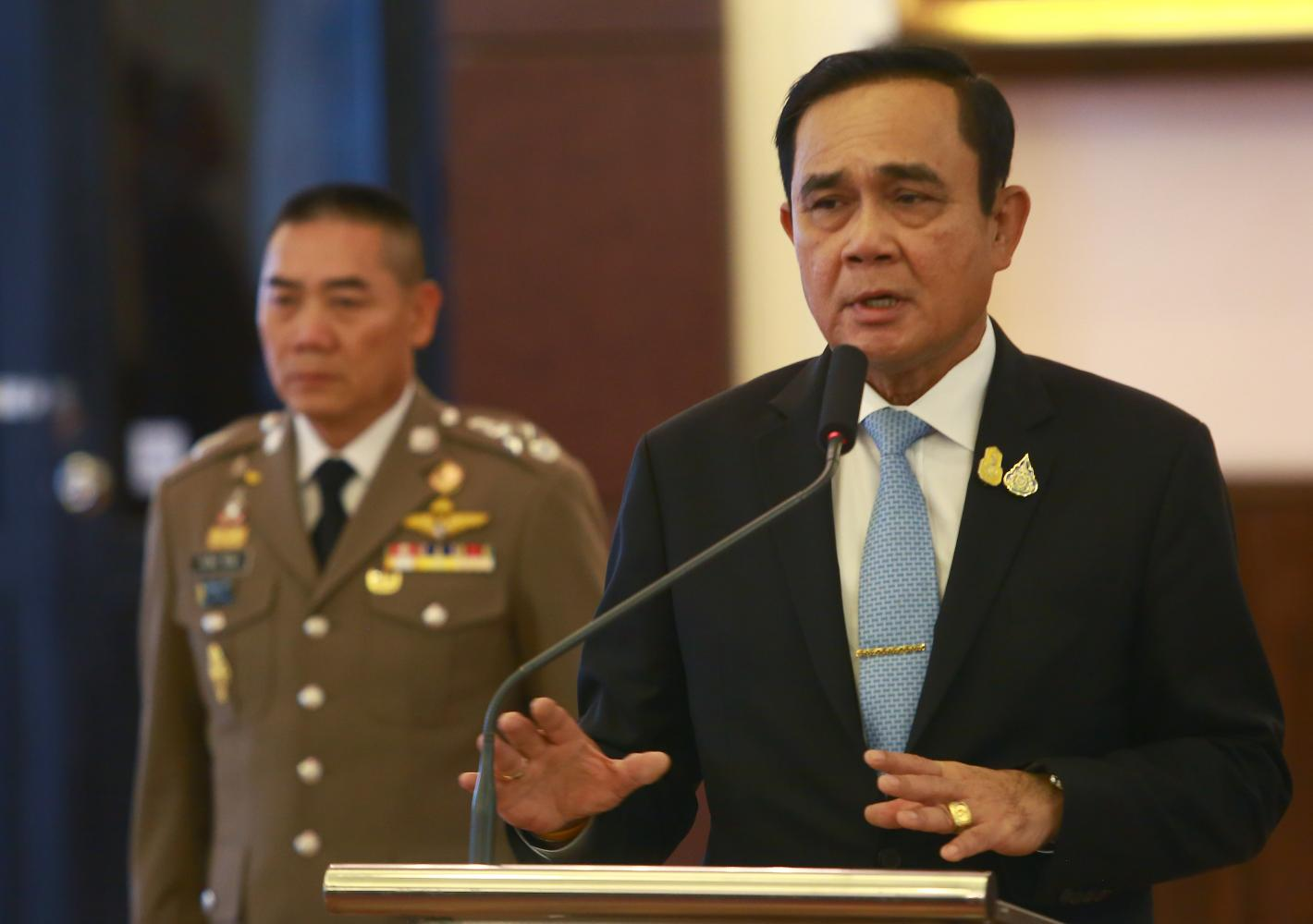 Prime Minister and Defence Minister Prayut Chan-o-cha speaks at the Royal Thai Police headquarters on Friday. He has announced he would oversee the force to drive police reform.SOMCHAI POOMLARD