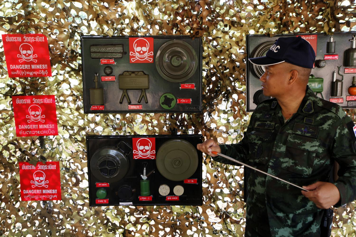 An officer shows different types of landmines during a press conference about the Defence Ministry's operation to destroy 3,133 landmines in Phakdi-Phandin village in Sa Kaeo.(Photo by Wichan Charoenkiatpakul)