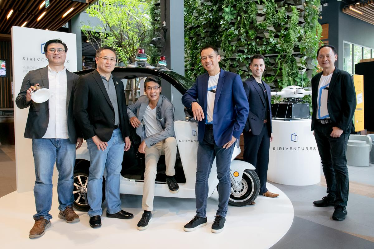 Autonomous cars and air-taxi drones are a trend, says Mr Jirapat (third right).