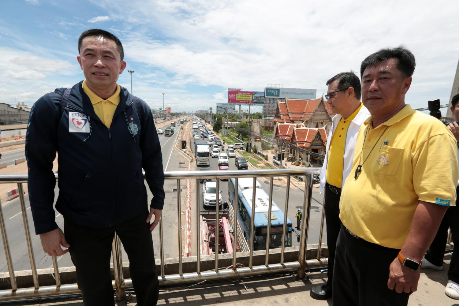 Transport Minister Saksayam Chidchob, left, inspects a road improvement project in Bangkok late last month. CHANAT KATANYU