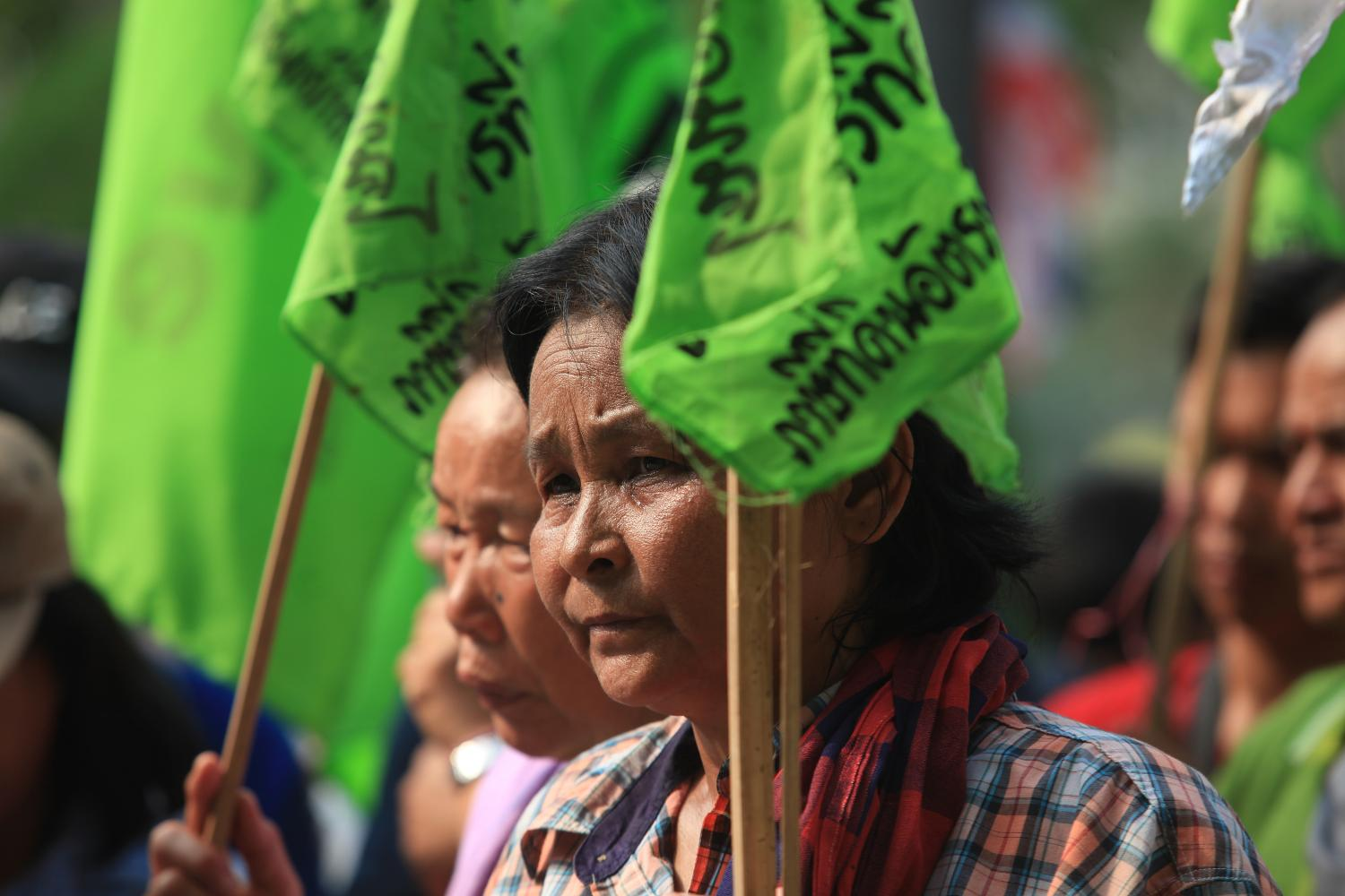 Local villagers join a demonstration led by P-Move, a grassroots group which campaigns for land rights for the poor, in February this year.  Somchai Poomlard