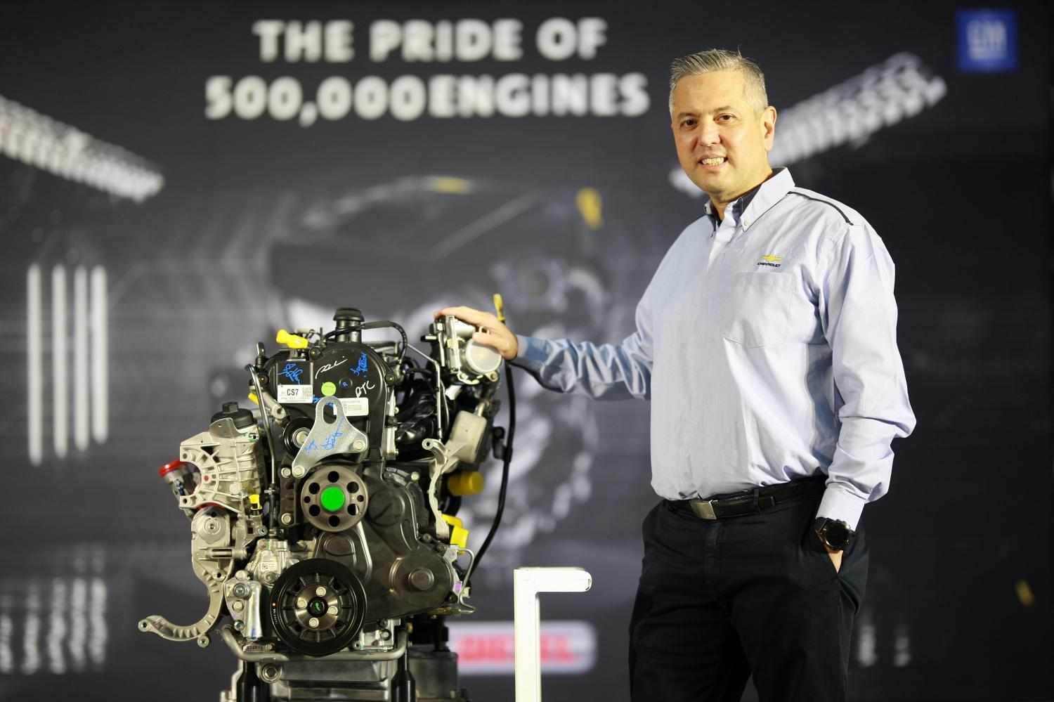 Mr Villarreal with the four-cylinder Duramax turbo-diesel engine. GM has made its 500,000th such engine at its Rayong plant.