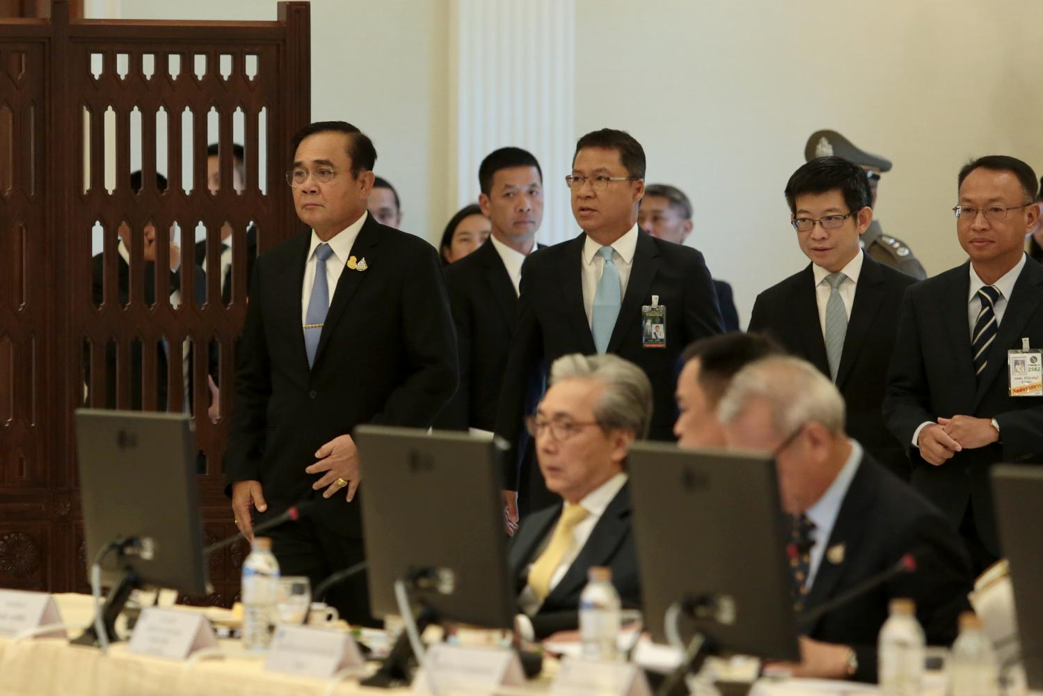 Prime Minister and Defence Minister Prayut Chan-o-cha (left) heads the first meeting of economic ministers on Friday to roll out stimulus measures to boost the sluggish economy at Government House.(Photo by Chanat Katanyu)