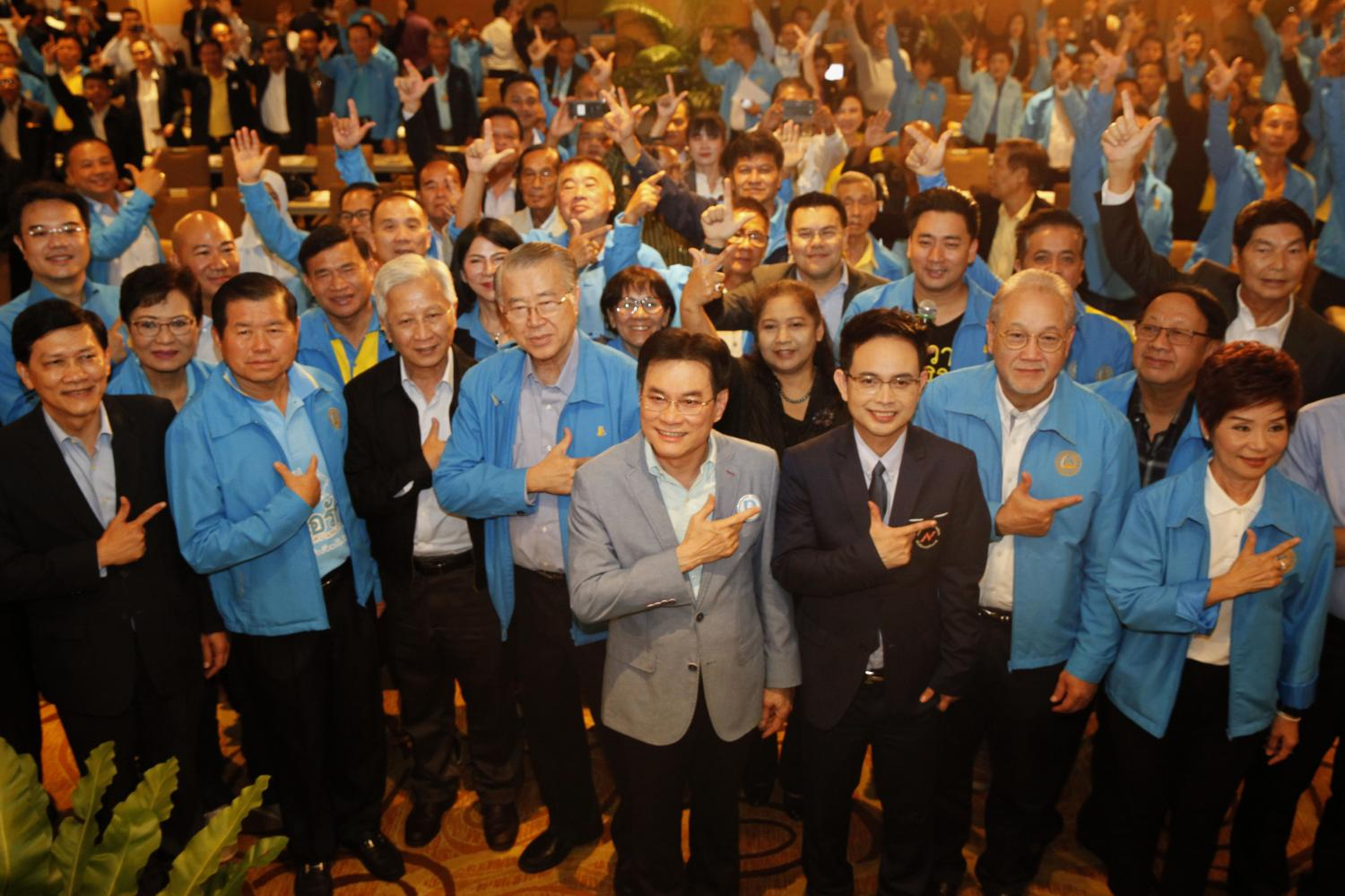 old is new again: Democrat leader and Commerce Minister Jurin Laksanawisit, middle, poses for a group photo with party members who gathered yesterday in Bangkok to brainstorm ideas to strengthen the 73-year-old party.