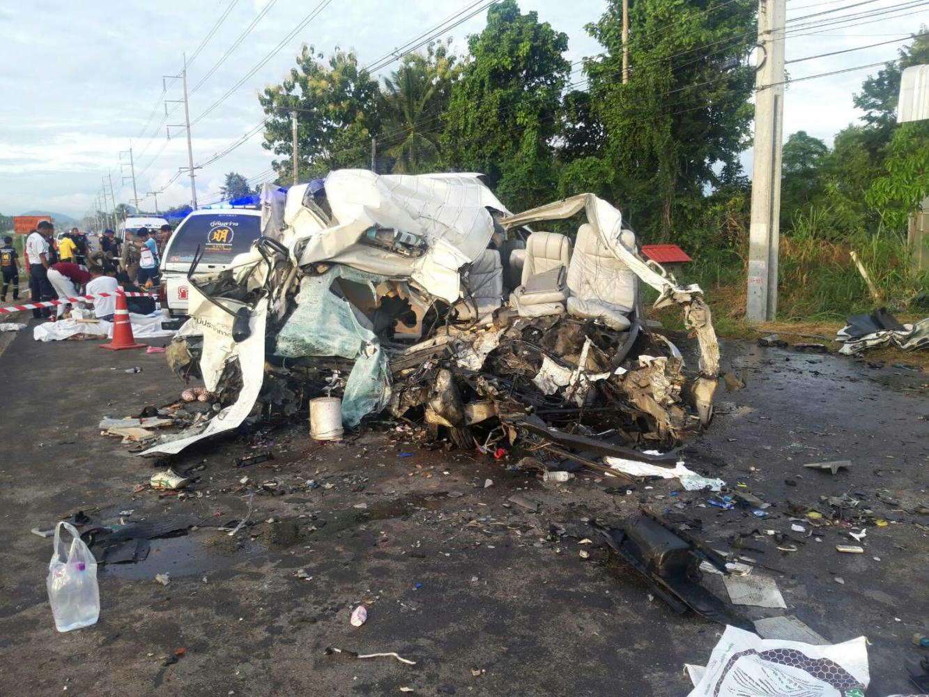 A passenger van destroyed after a collision with a lorry in Wang Sombun district of Sa Kaeo province on Sunday.Sawat Ketngam