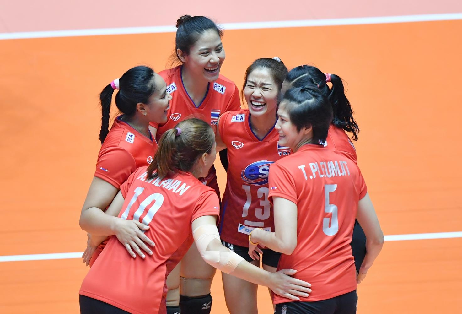 Thailand players celebrate winning a point against Iran.