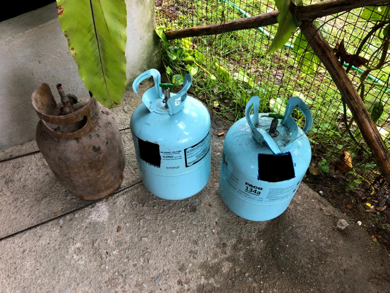 Explosive find: Two coolant cylinders, cut open; one empty LPG cylinder and steel rods were found in a suspect's house in Bacho district of Narathiwat yesterday.