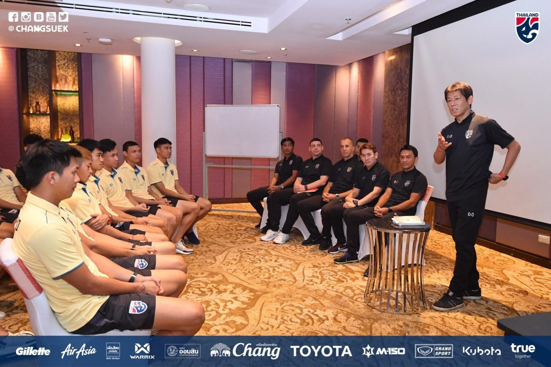 Thailand coach Akira Nishino talks to his players at the team's training camp.