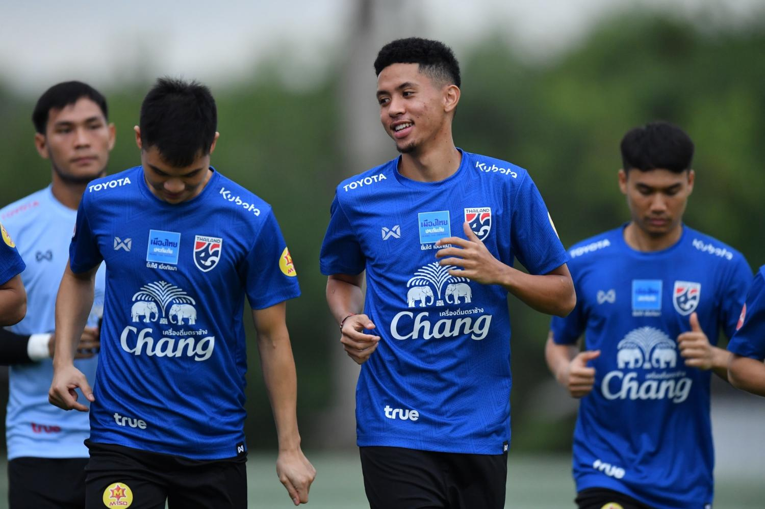 Thailand midfielder Bordin Phala, second right, attends a training session on Friday.