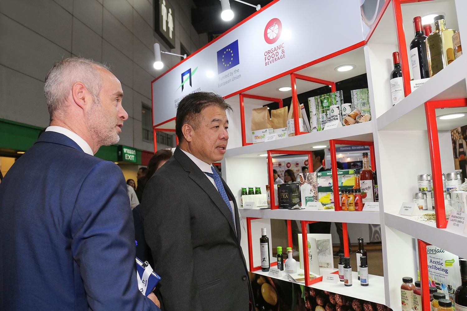 Laurent Lourdais, counsellor of the EU delegation to Thailand, tours the EU pavilion at Food & Hotel Thailand with tourism permanent secretary Chote Trachu. The expo at Bitec ends Saturday.