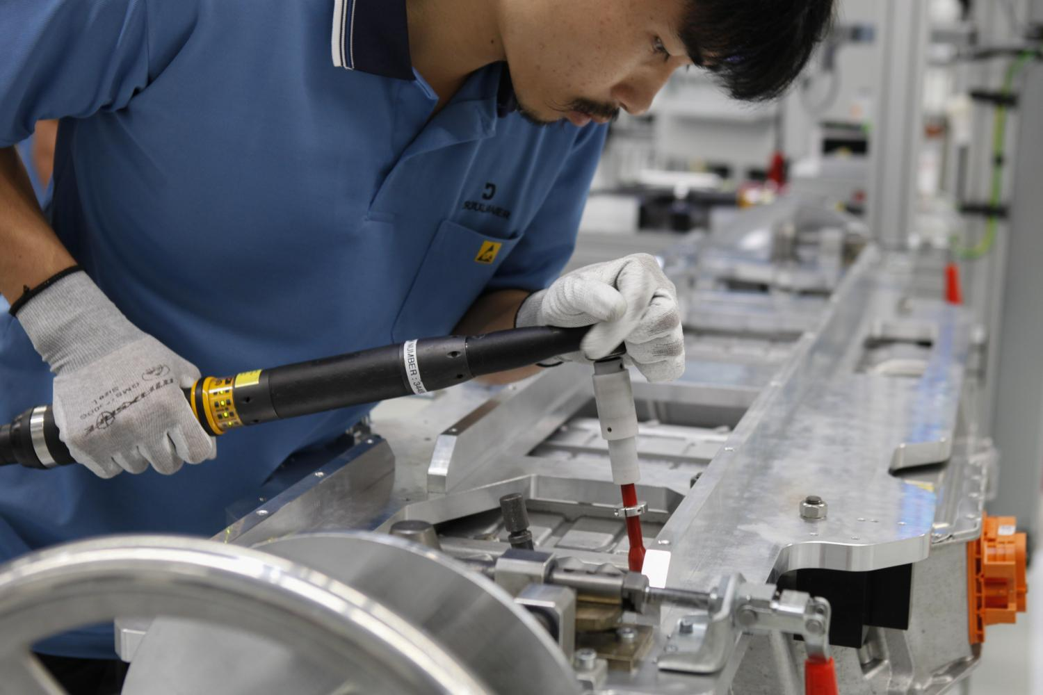 A Draexlmaier worker packs modules for high-voltage batteries at the plant in Chon Buri. BMW plans to use this output to lower the cost of locally assembled plug-in hybrid EVs.