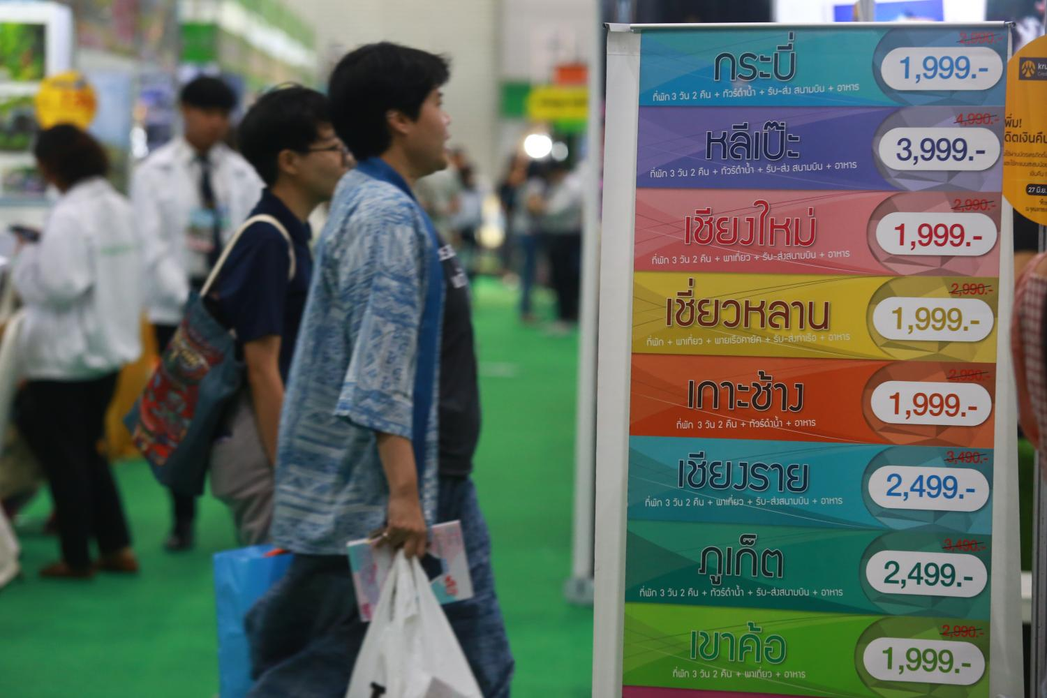 Domestic tourism packages on offer at a tourism fair. (Photo by Somchai Poomlard)