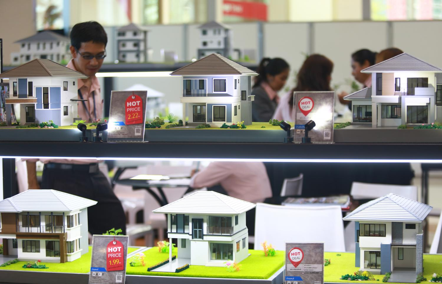 Models of two-storey residential units are on display during the House & Condo Fair at Siam Paragon. (Photo by Somchai Poomlard)