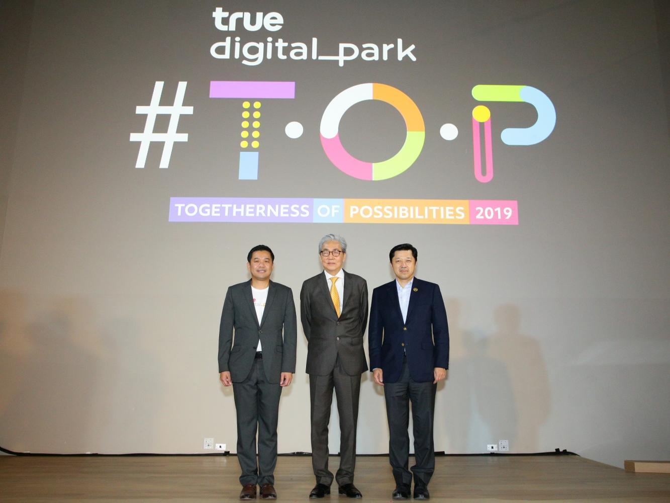 Deputy Prime Minister Somkid Jatusripitak (centre) presided over Wednesday's opening ceremony at the Togetherness of Possibilities 2019 tech conference. He was welcomed by Mr Suphachai (right) and Thanasorn Jaidee, president of True Digital Park.