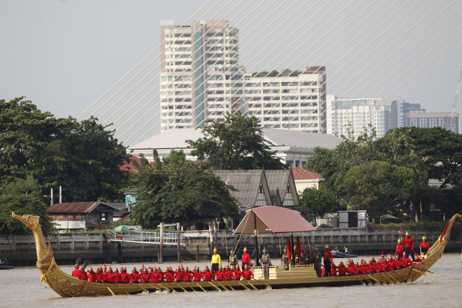 prepping for the big day: The royal navy puts on a rehearsal of the royal barge procession for His Majesty the King comprising 52 barges and boats in preparation for the royal 'kathin' (monk's robe-giving) ceremony next month, including the principal Suphannahong Royal Barge (pictured).