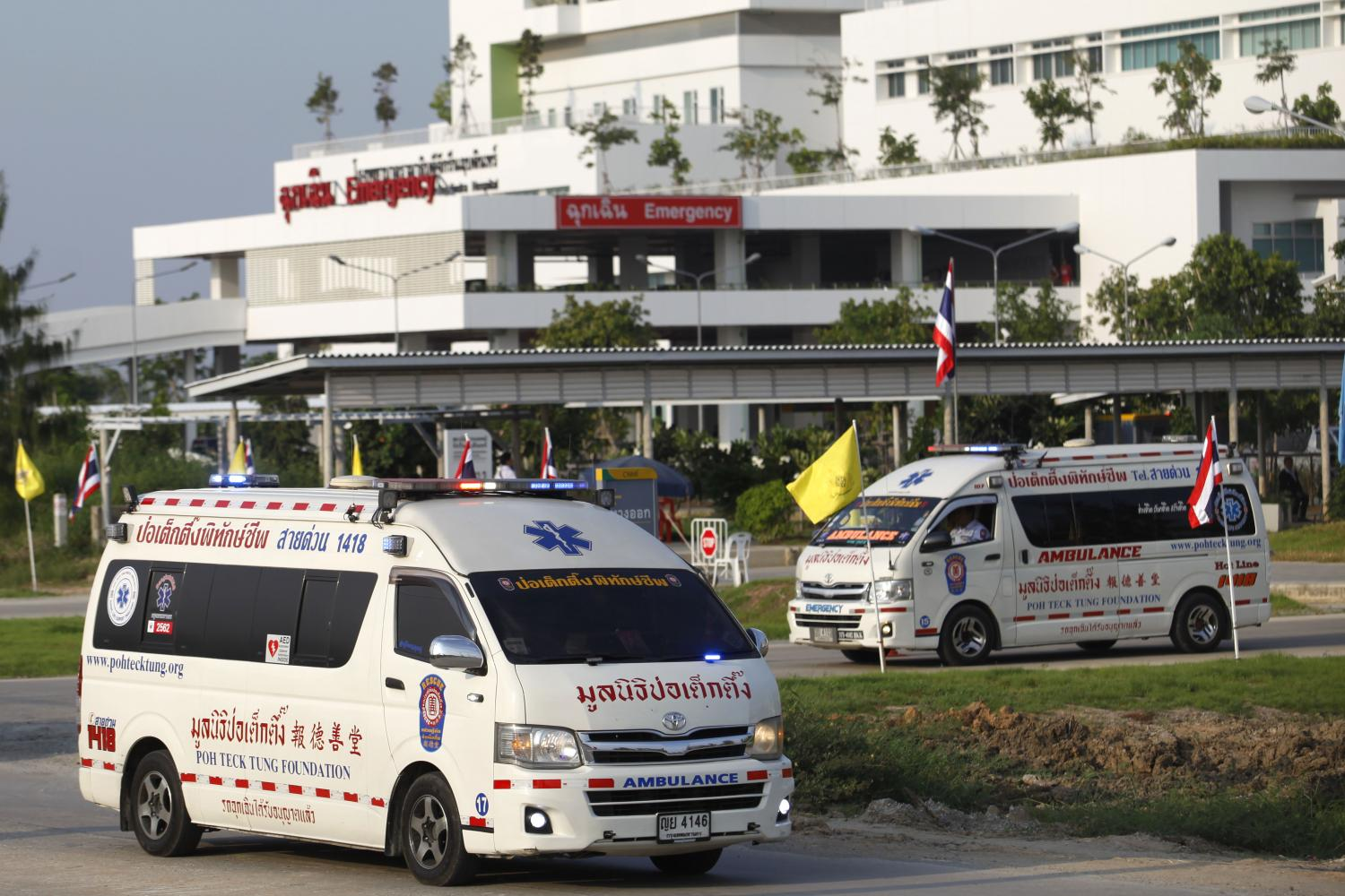 Vans carry the 13 victims killed in a pickup truck accident from Chakri Naruebodindra Medical Institute for funeral rites.Wichan Charoenkiatpakul