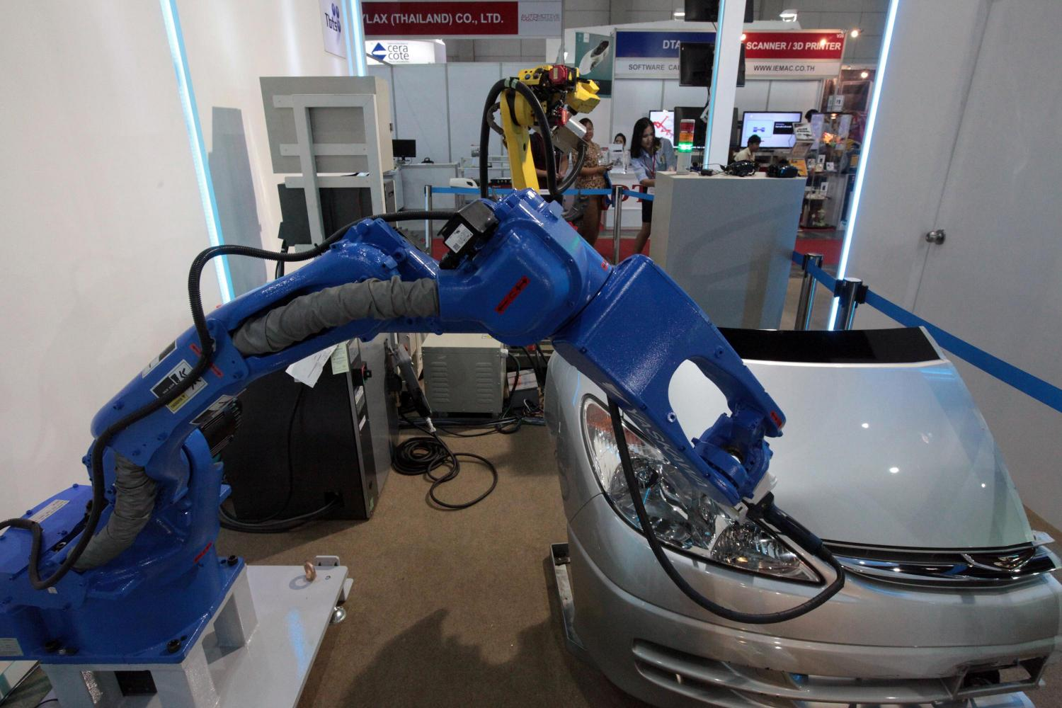 A robot manufactures a car at an expo, promoting a full spectrum of technologies.Weerawong Wongpreedee