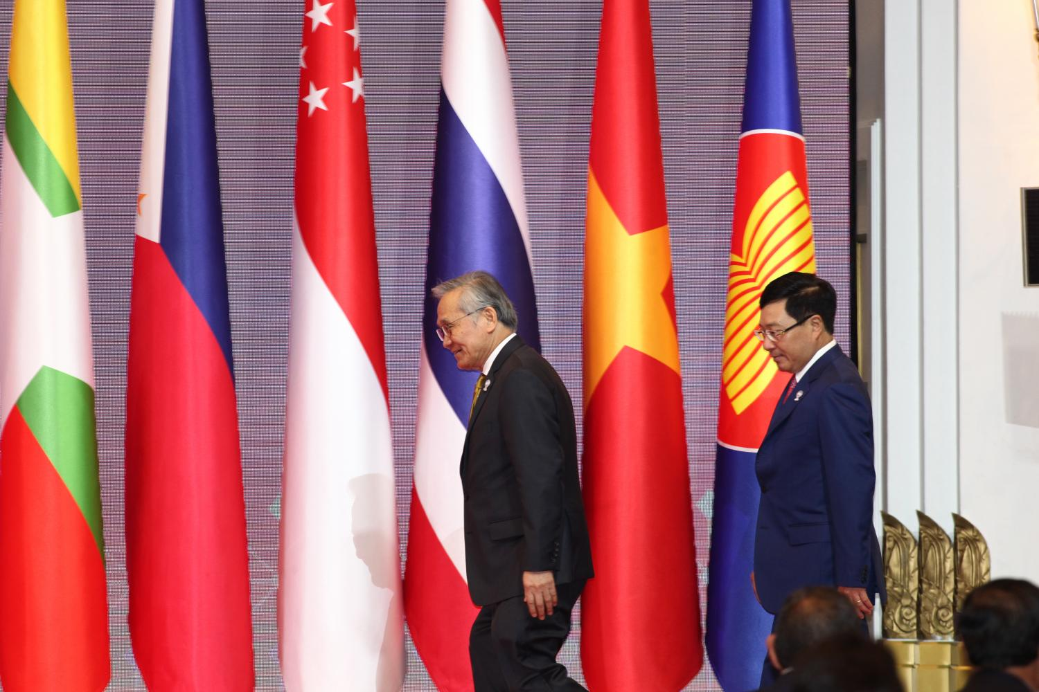 Thailand's Foreign Minister Don Pramudwinai, left, and Vietnam's Deputy Prime Minister and Foreign Minister Pham Binh Minh at the Asean Foreign Ministers' Meeting in Bangkok in June. Vietnam becomes Asean chair next year. PATTARAPONG CHATPATTARASILL