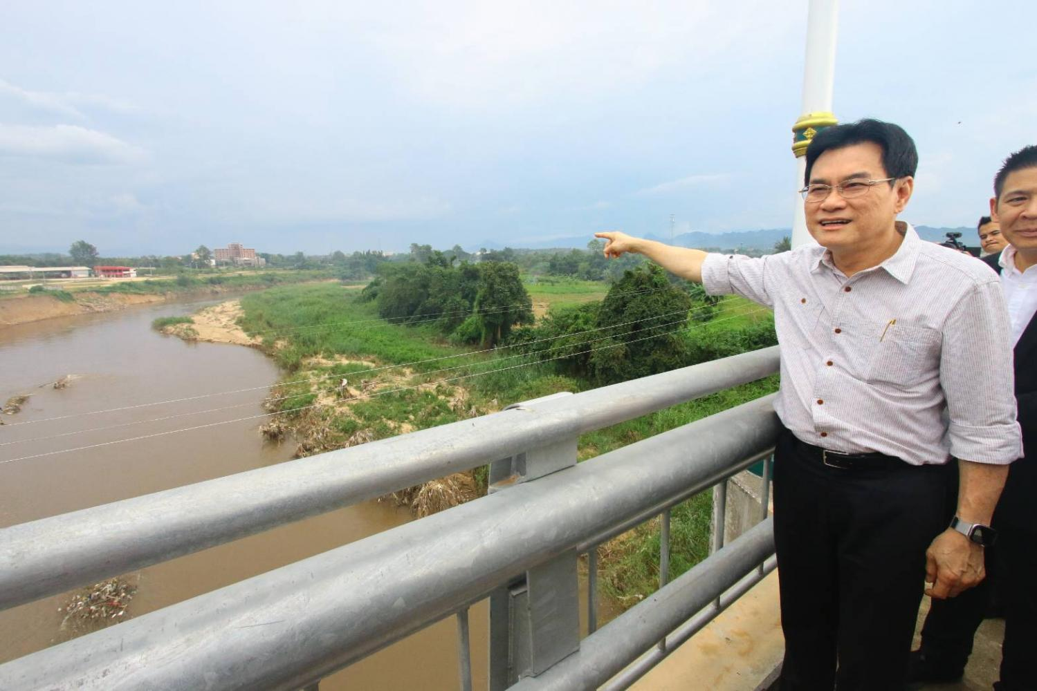 Mr Jurin points from the second Thai-Myanmar Friendship Bridge in Mae Sot district of Tak province on Thursday.