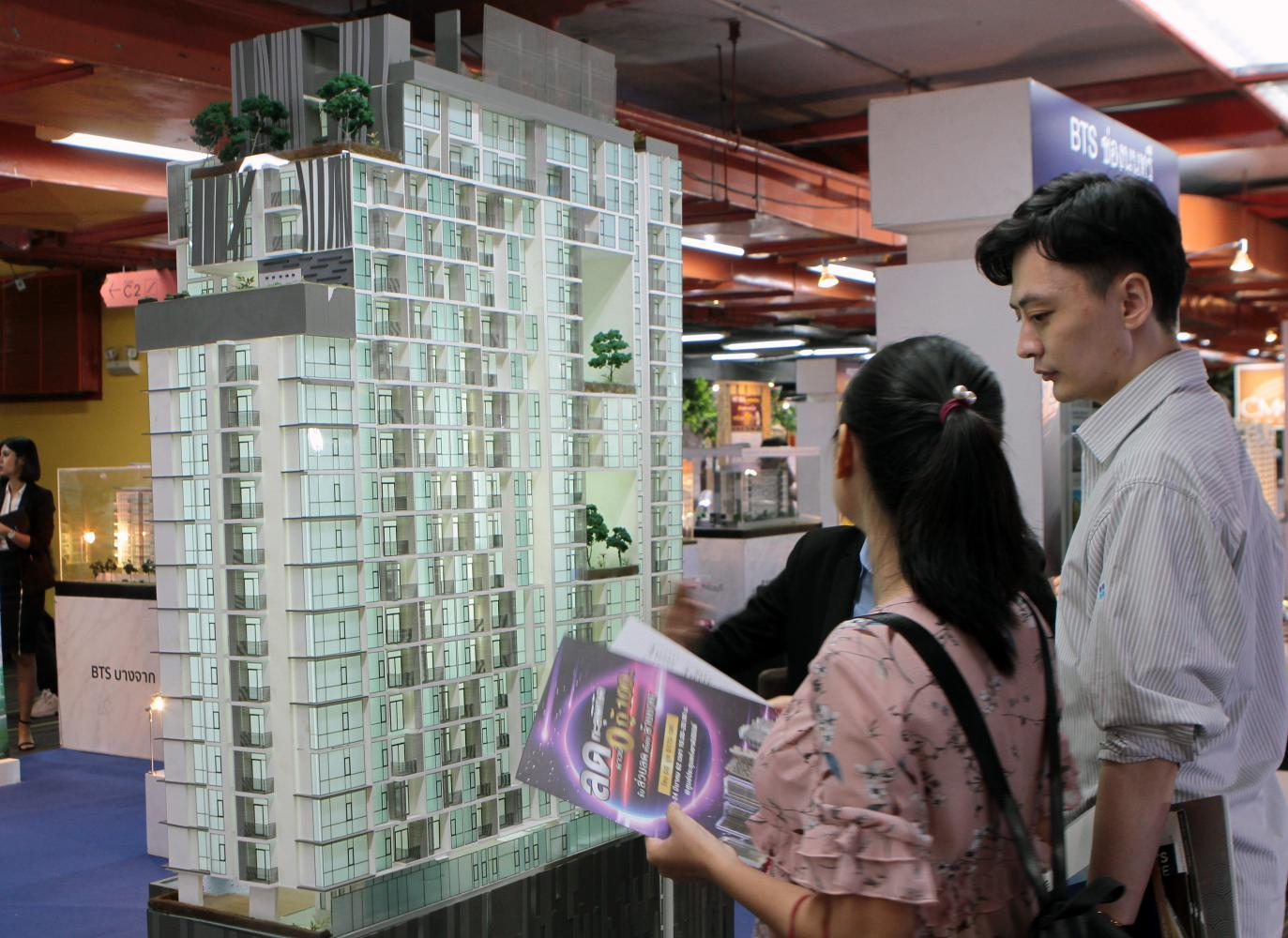 Visitors check out a housing fair. Juwai says a residency golden visa scheme can help boost property sales among Chinese. (Photo by Tawatchai Kemgumnerd)
