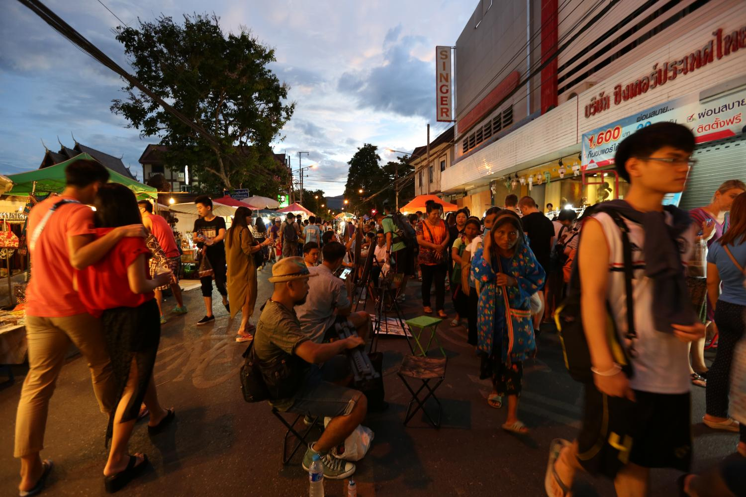 People walk and shop on the packed Tha Pae Walking Street in Chiang Mai. (Bangkok Post photo)