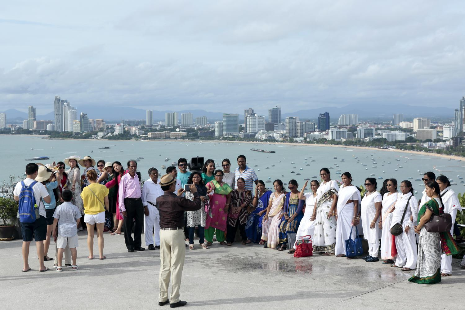A group of Indian tourists pose for pictures at Phra Tamnak Hill in Pattaya. Photo: Patipat Janthong