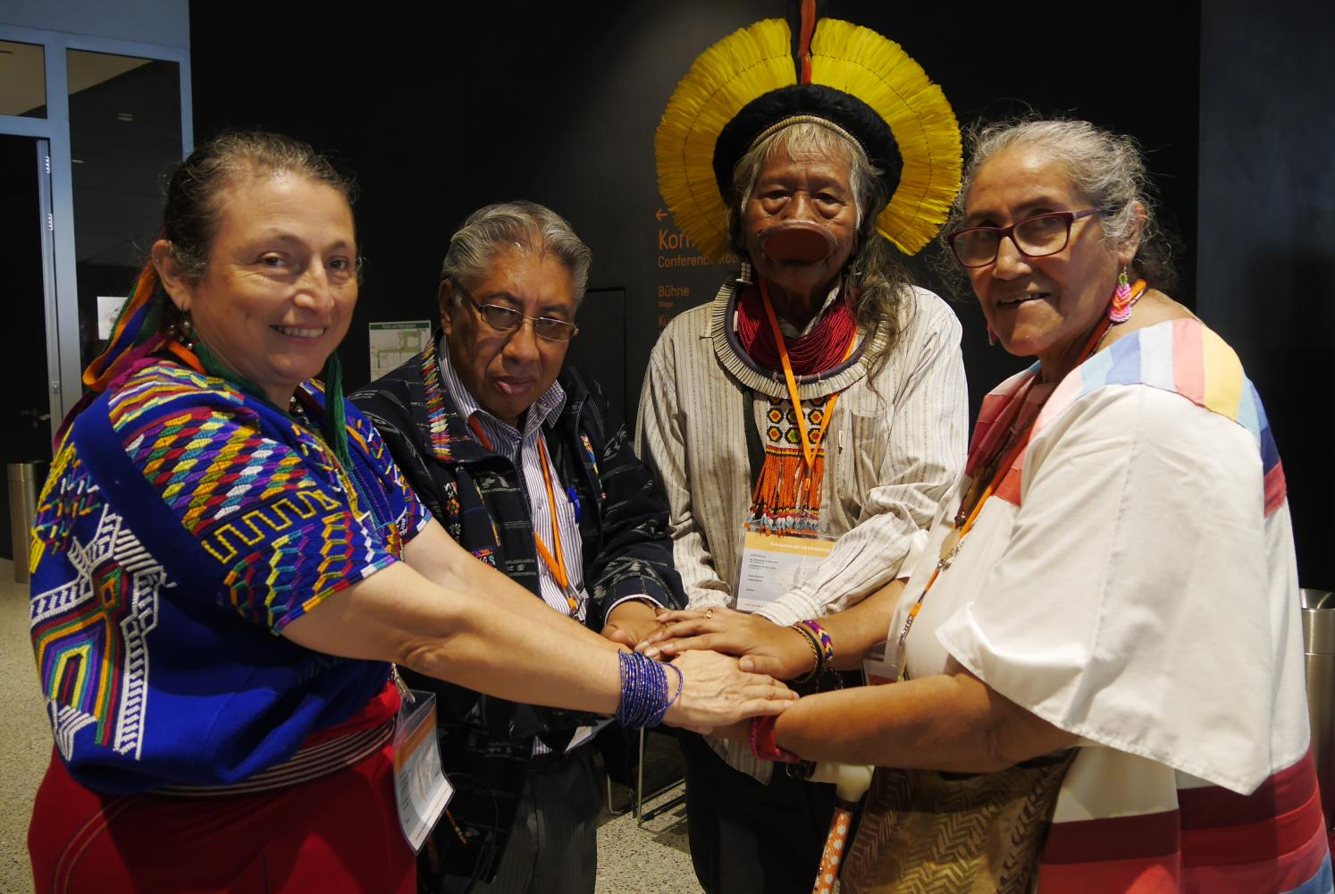 A group of indigenous leaders from Central and South America join hands in a symbolic gesture to fight against the violence of governments and agribusinesses that is destroying their forest homes.