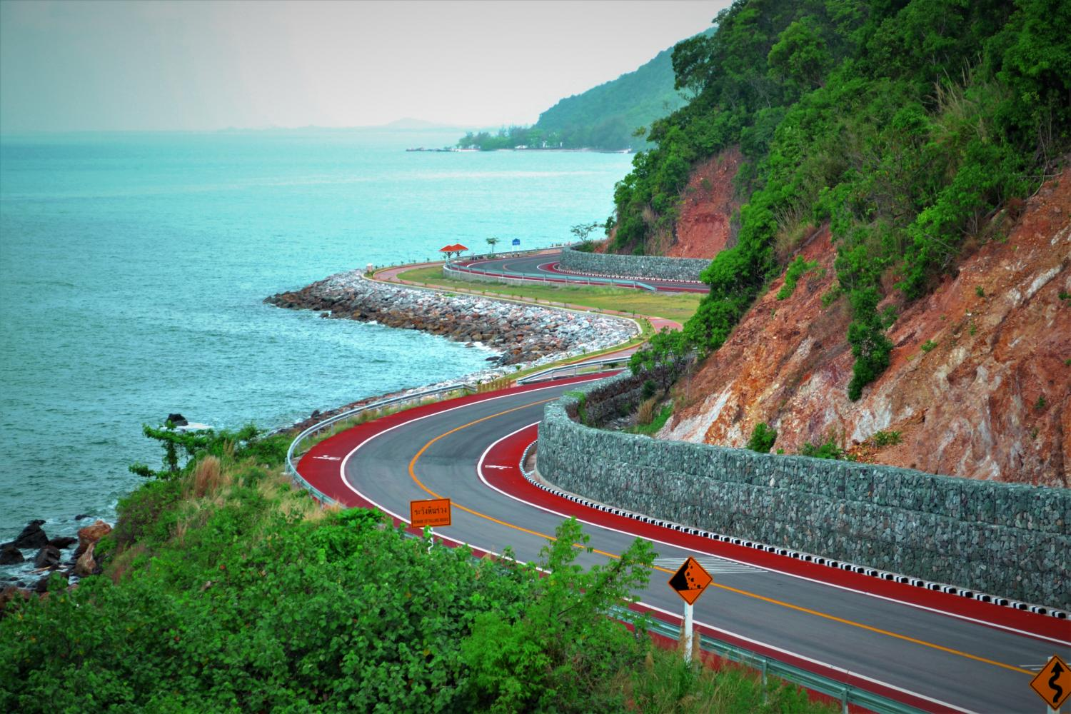A scenic stretch of royally-initiated Chaloem Burapha Chonlathit Road meanders along the coast in Chanthaburi.(Department of Rural Road photo)