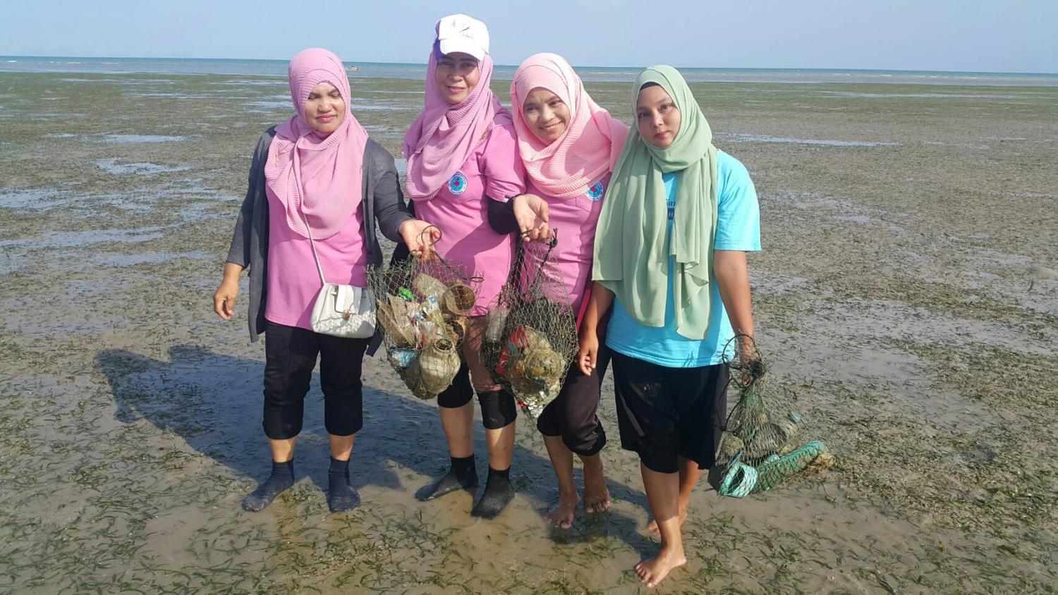 Villagers on Koh Libong gather to collect plastic garbage from seagrass meadows. Dumrongkiat Mala