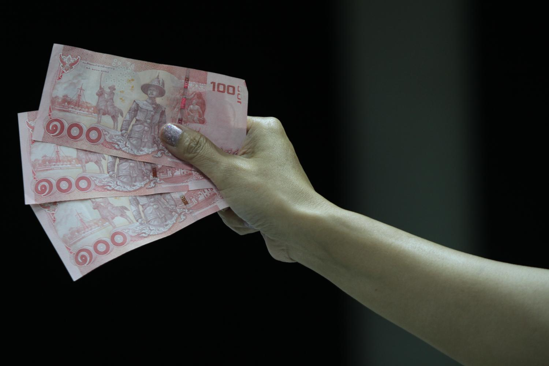 The baht could appreciate to 29 per US dollar, says KTAM. (Photo by Panumas Sanguanwong)