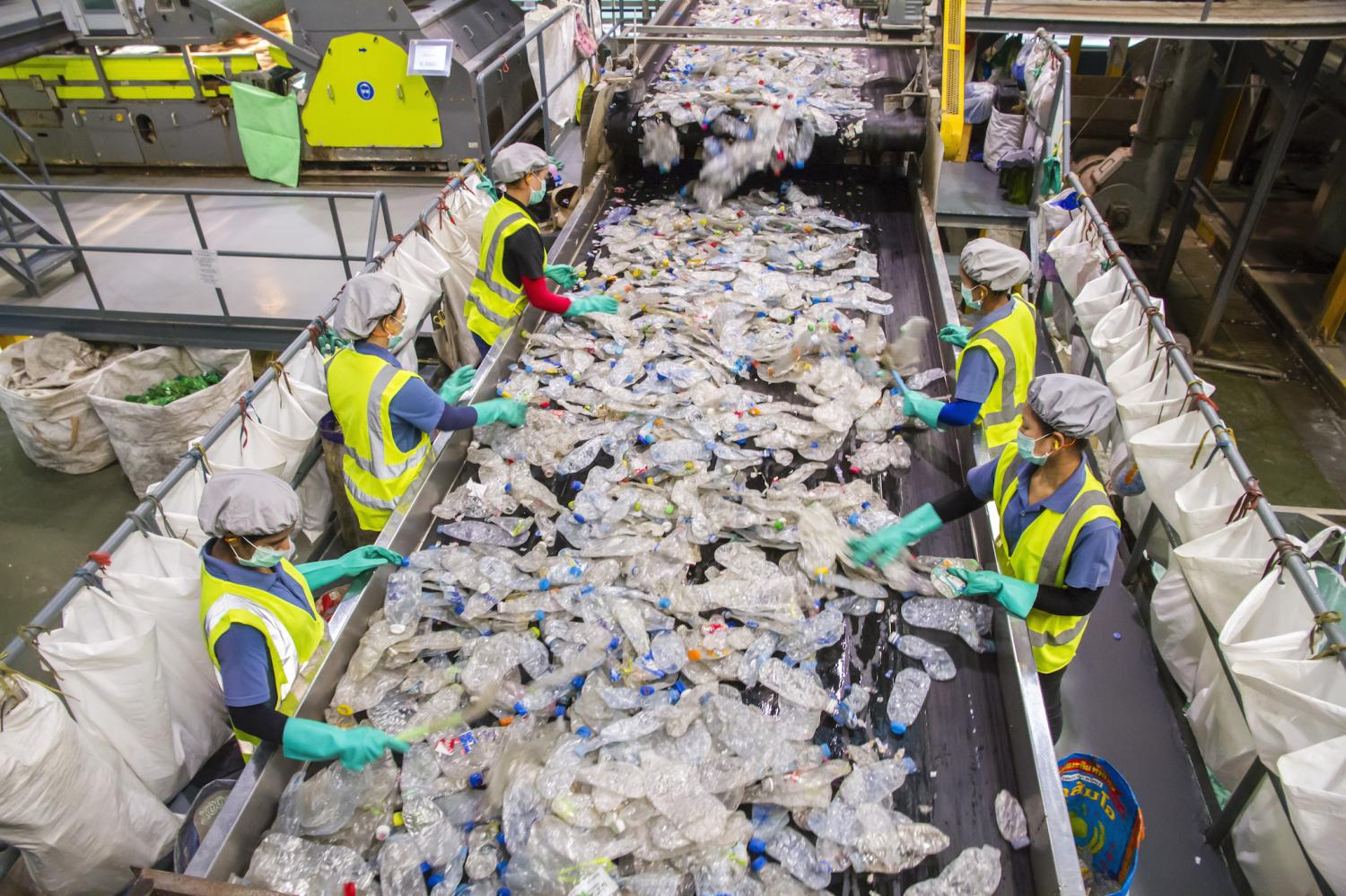 Workers sort post-consumer PET bottles at the Indorama Ventures plastic recycling factory in Nakhon Pathom. A total of 1.65 billion PET bottles were recycled into PET plastic pellets over five years.