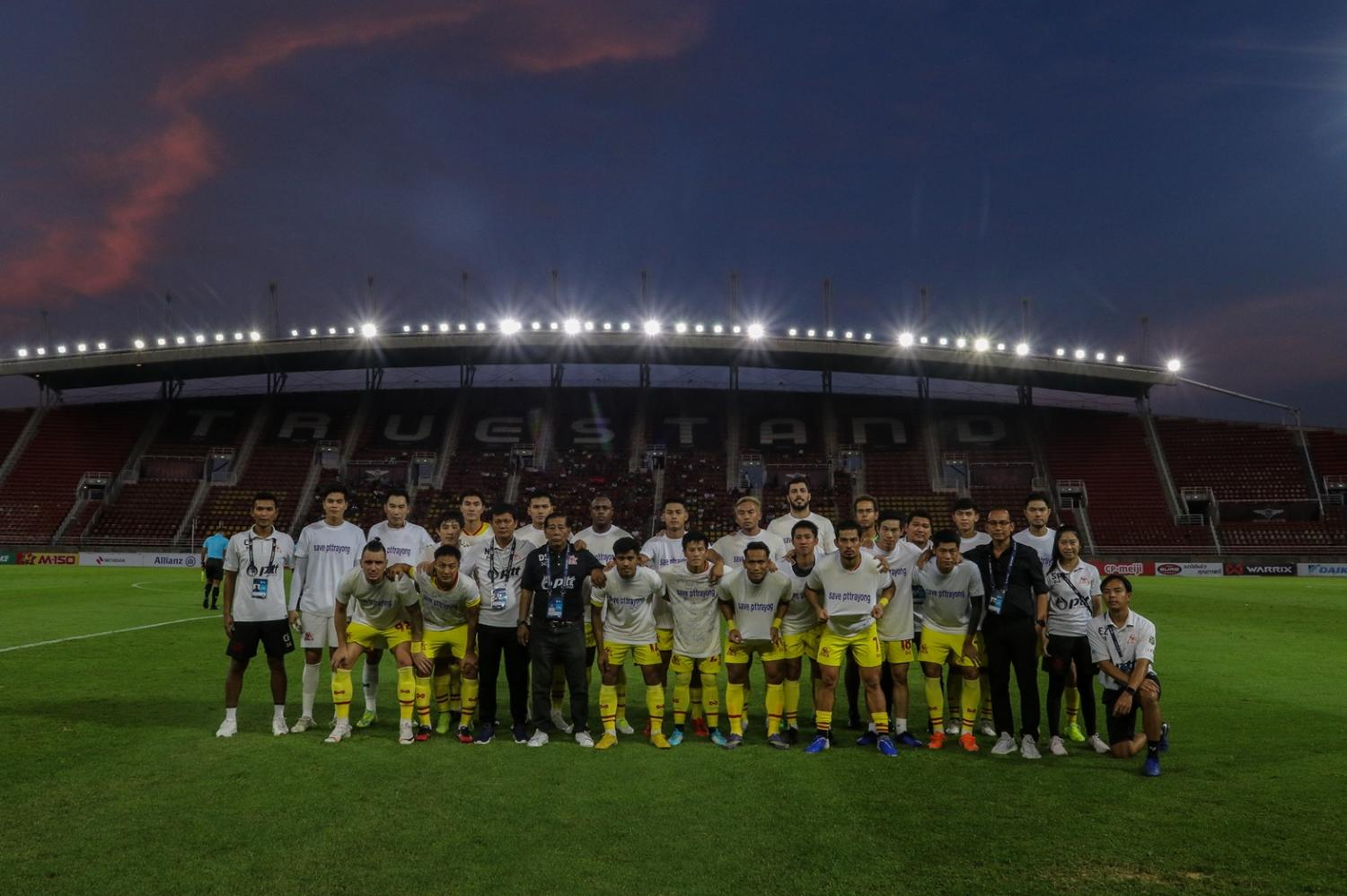 PTT Rayong players and officials pose at True Stadium after the final match of the 2019 season on Saturday.