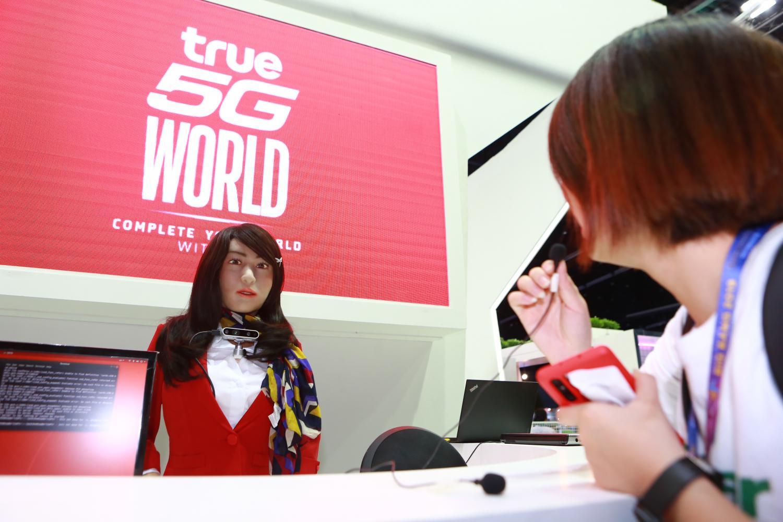 Visitors talk to a humanoid robot displayed at Digital Thailand Big Bang 2019. The event runs until Thursday.(Photo by Somchai Poomlard)