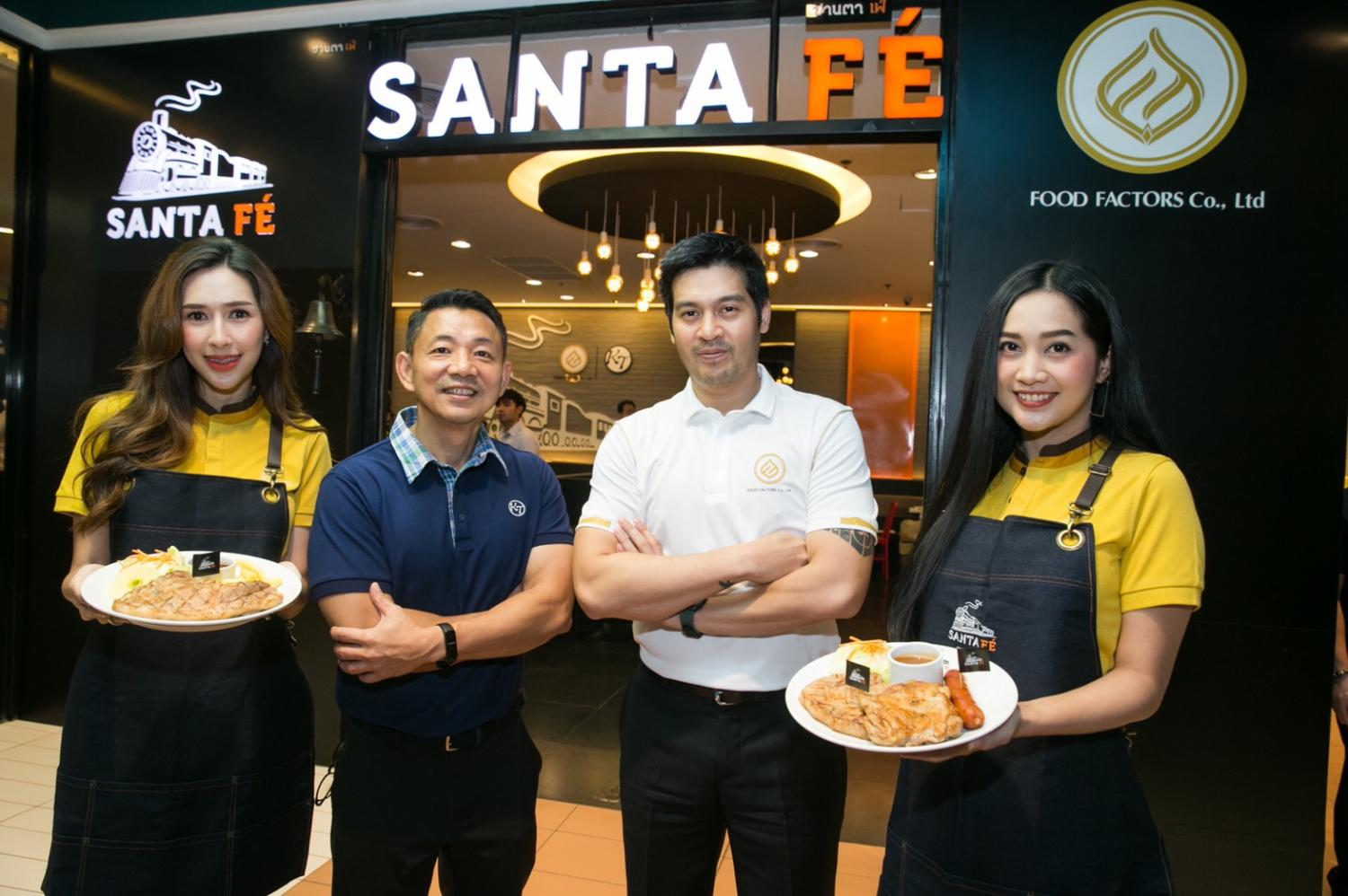 Mr Piti, second right, and Surachai Chananudej, chief executive of KT Restaurant Co, second left display some menu items from Santa Fe eatery.