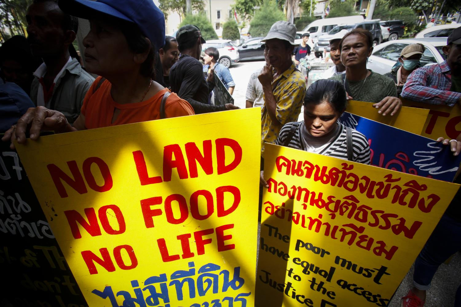 Land rights activists protest in Bangkok last month, calling for the government to come up with policies to address widening inequality.