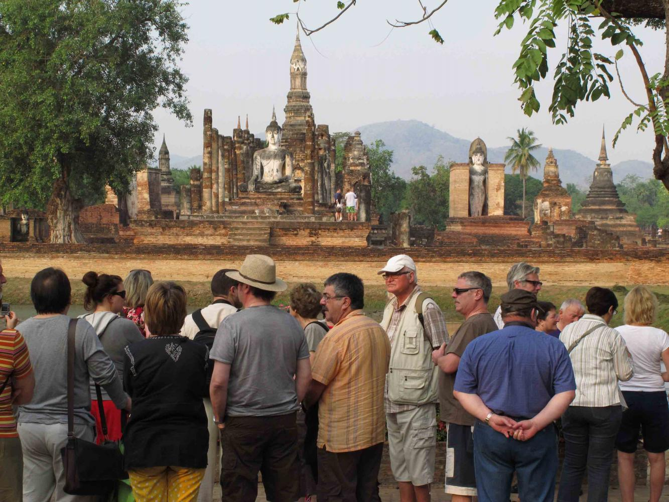 Foreign tourists visit Sukhothai Historical Park. Sukothai has been added to the list of Unesco Creative Cities.