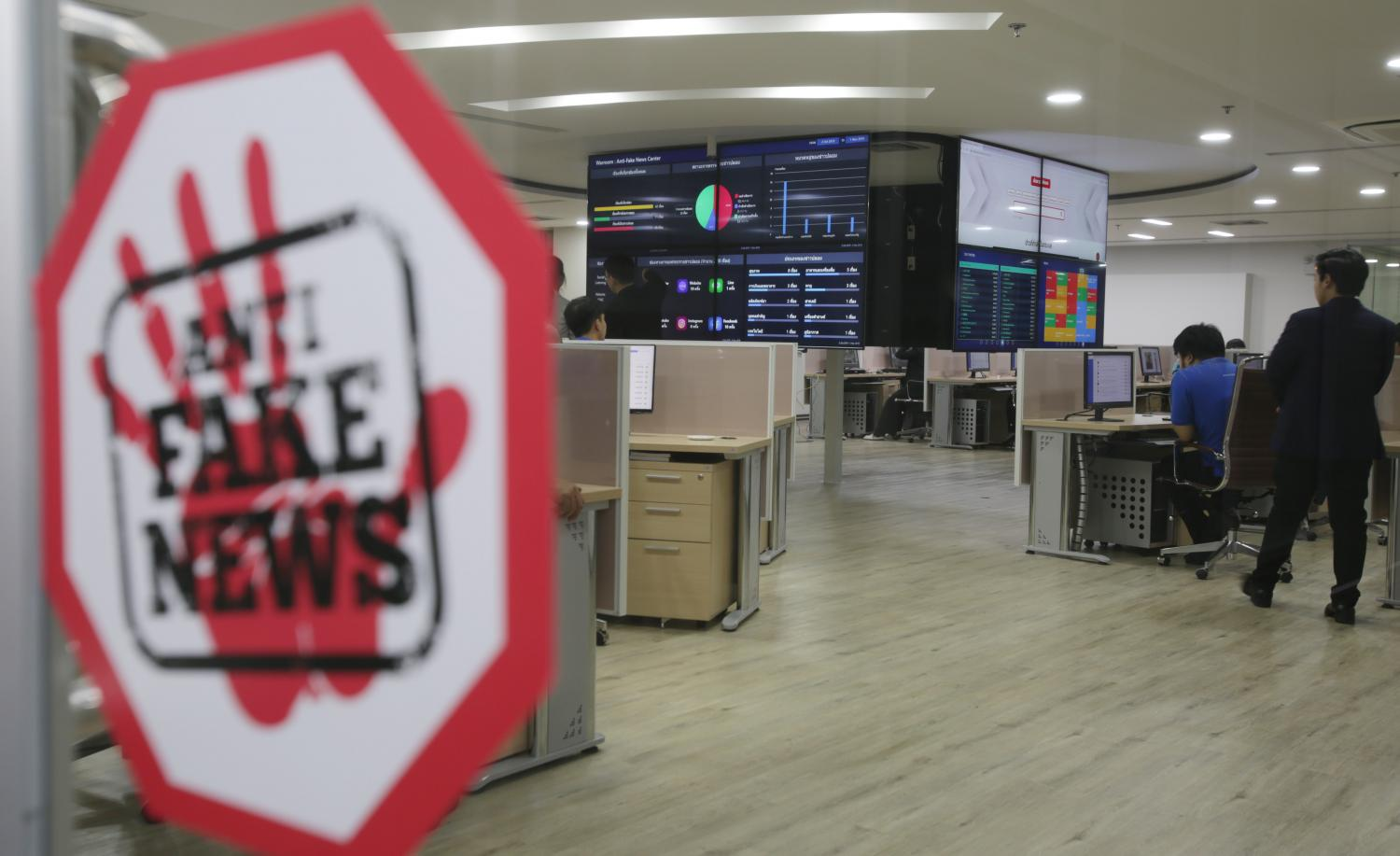 This image shows the anti-fake news centre at the Ministry of Digital Economy and Society, which was set up to monitor social media. Apichit Jinakul