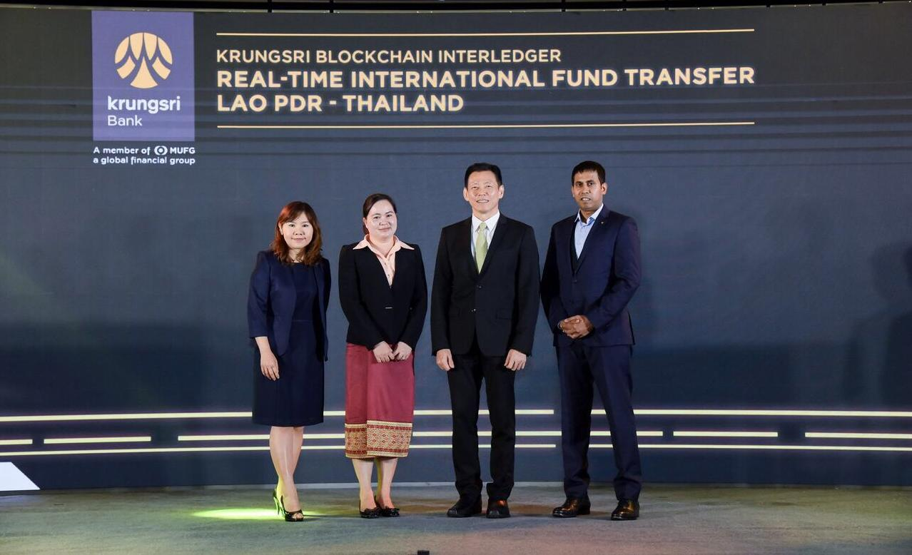 Mr Harsono, second right, Lammone Simmalavong, second left, deputy director-general, the Lao central bank, Patcharin Boonlumsun, left, head of commercial digital solutions at BAY, and Ajeesh Sadanand, chief technology officer, SBI Ripple Asia, introduce Krungsri Blockchain Interledger.