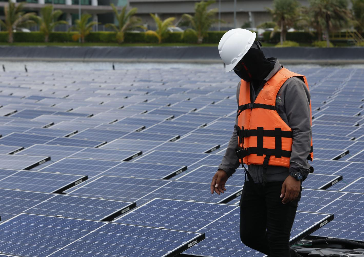 A man works at a solar power project in Rayong. The use of lithium-ion batteries in the whole energy supply chain in Thailand is still limited. (Photo by Pattarapong Chapattarasill)