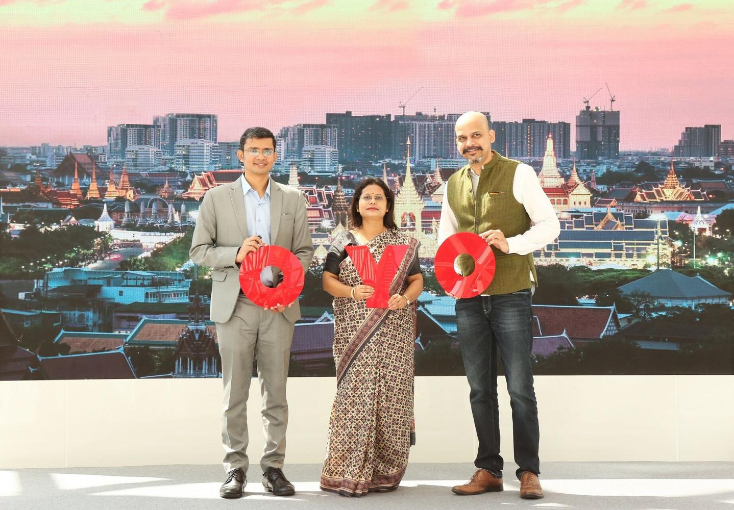 Mr Vaidya (right), Mrs Dubey and Mr Singh celebrate the arrival of the Oyo budget hotel chain in Thailand.