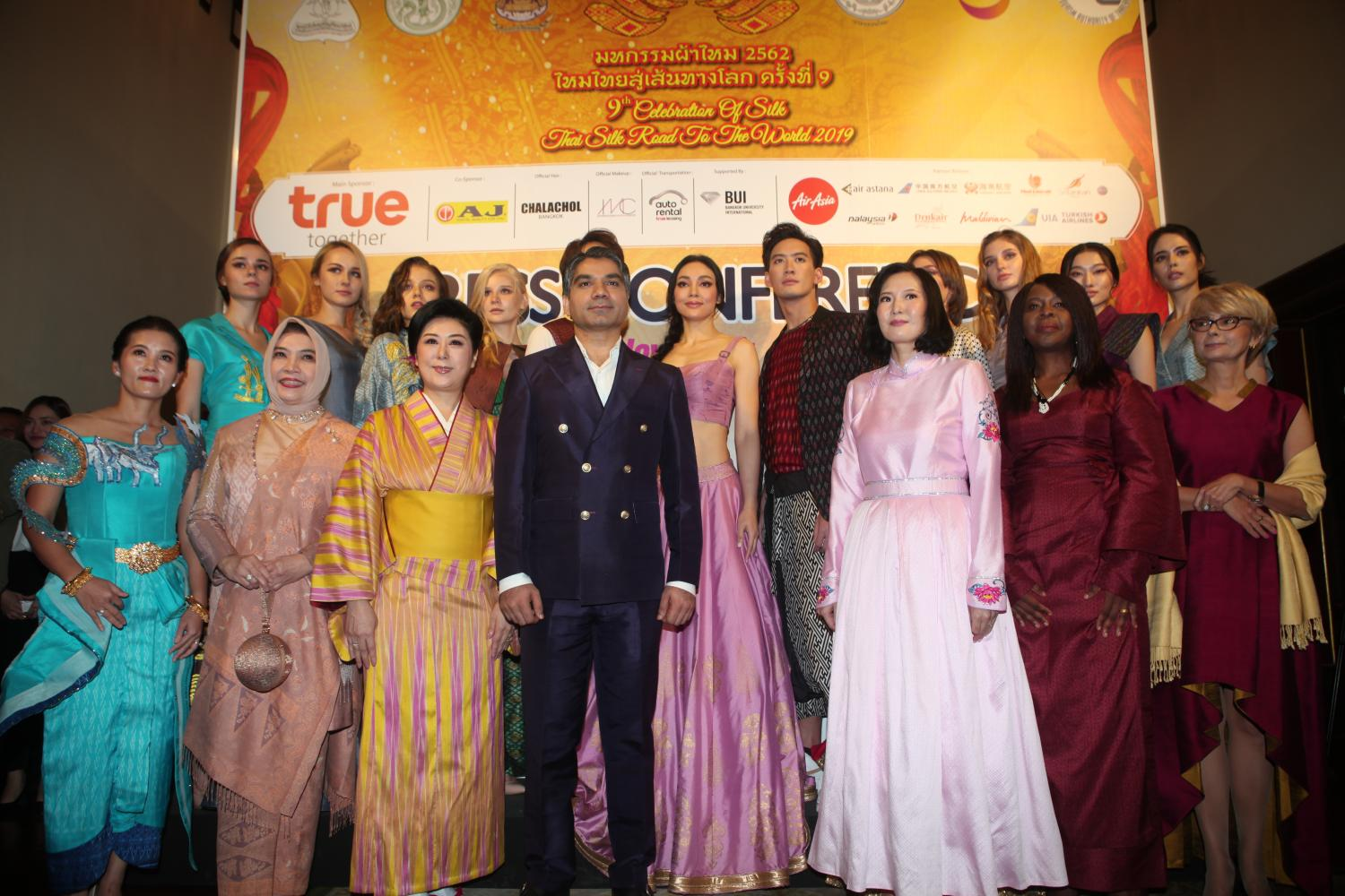 Diplomats in attire made of Thai silk help promote the 'Celebration of Silk, Thai Silk Road to The World 2019' to be held this month.(Photo by Apichart Jinakul)