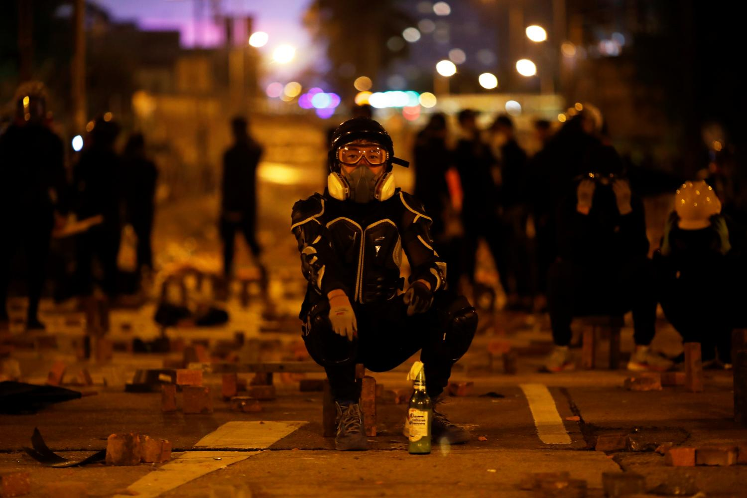 An anti-government protester is seen during clashes with police near the Polytechnic University in Hong Kong, China on Saturday.REUTERS