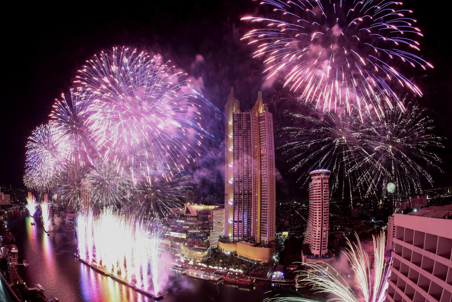 Fireworks lit up the Chao Phraya River in front of Iconsiam last New Year's Eve.PATIPAT JANTHONG
