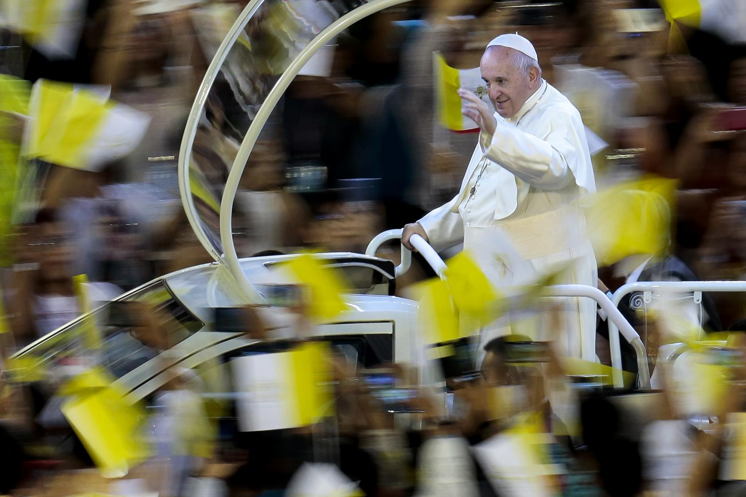 Pope Francis on Thursday arrives in his 'popemobile' to cheering crowds at the National Stadium. (Photo by Patipat Janthong)