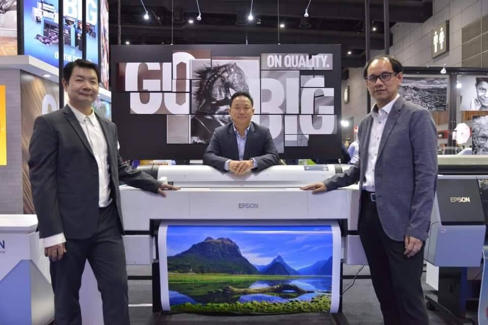 Mr Yunyong (centre) presents a new commercial and industrial printer by Epson during Photo Fair 2019 at Bitec.