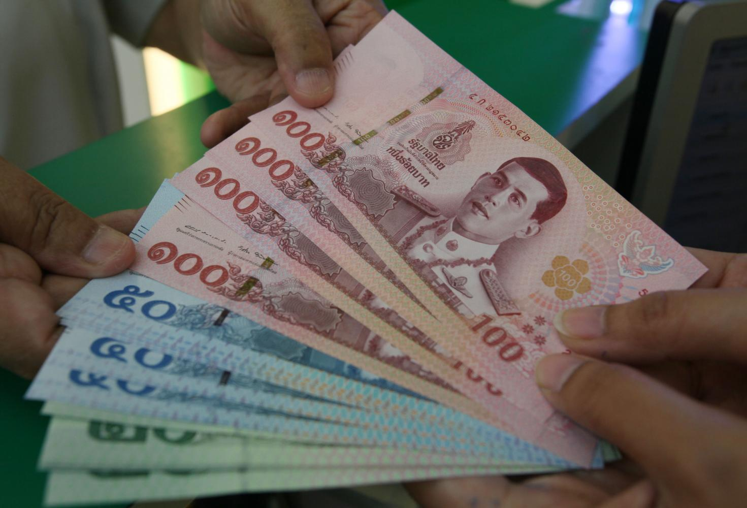 The baht is the top-performing currency in Asia, gaining almost 8% year-to-date against the US dollar. Apichit Jinakul